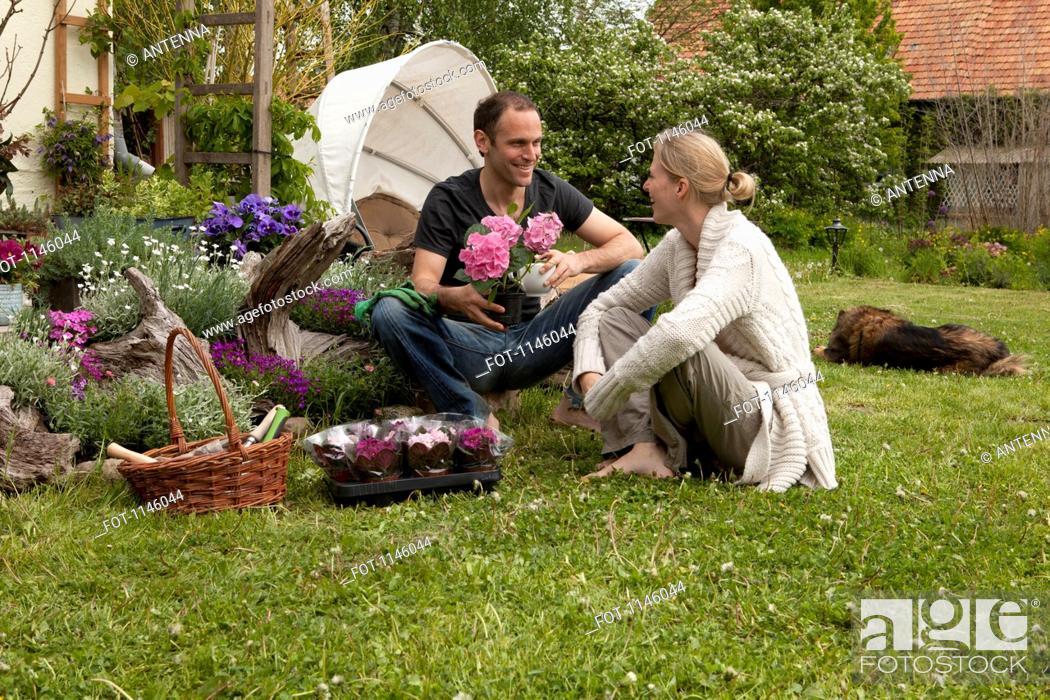 Stock Photo: A couple gardening in their backyard.