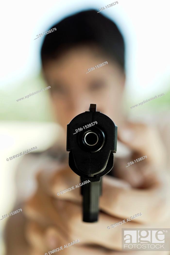 Stock Photo: boy with a gun.