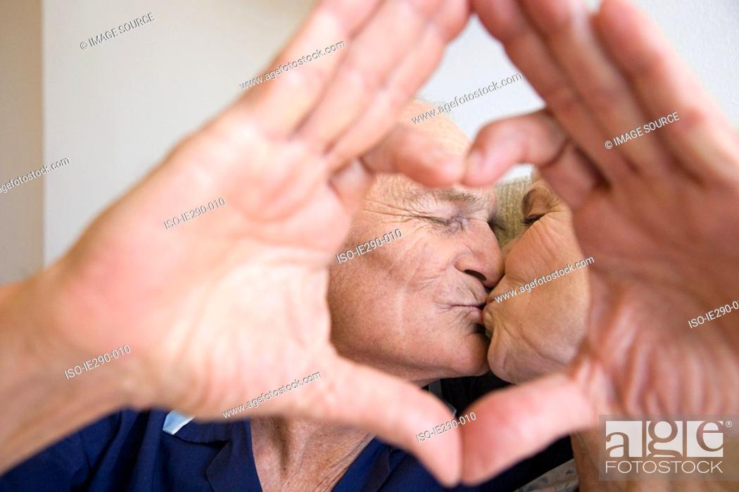 Stock Photo: A senior couple kissing.