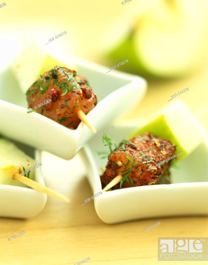 Stock Photo: Mini brochettes of marinated fish.