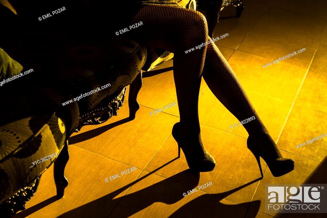 Photo de stock: Attractive woman's legs in high-heels.