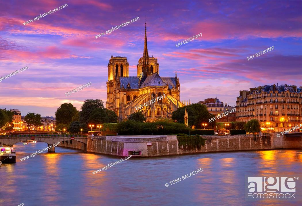 Stock Photo: Notre Dame cathedral in Paris sunset from Seine river in France.