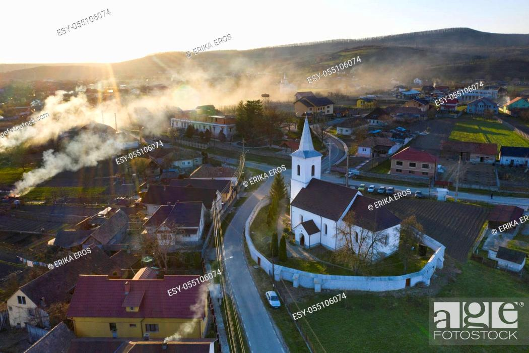 Stock Photo: Aerial view of a small village with old church in Transylvania, Romania.
