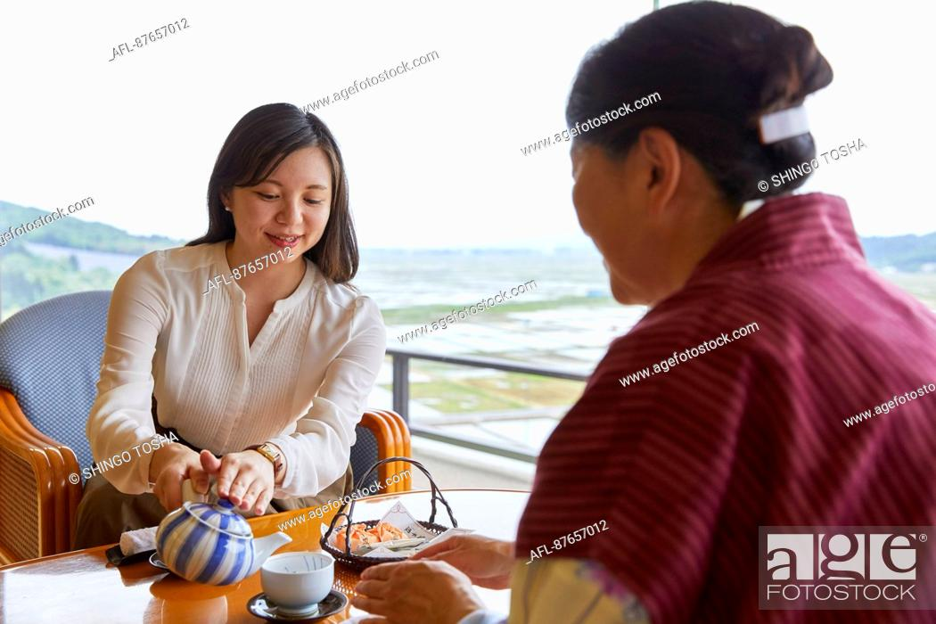 Stock Photo: Japanese women at a traditional hotel.