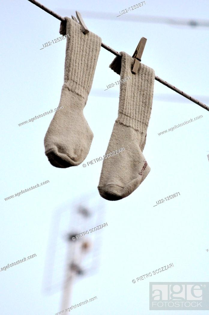 Stock Photo: Rimini (Italy), socks hanging on a string, a decoration in San Giuliano's neighborhood during the Festa de' Borg ('Hood party').