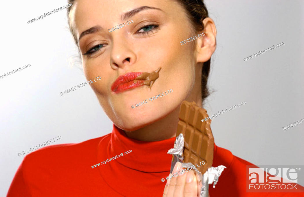Stock Photo: Young woman eating chocolate.
