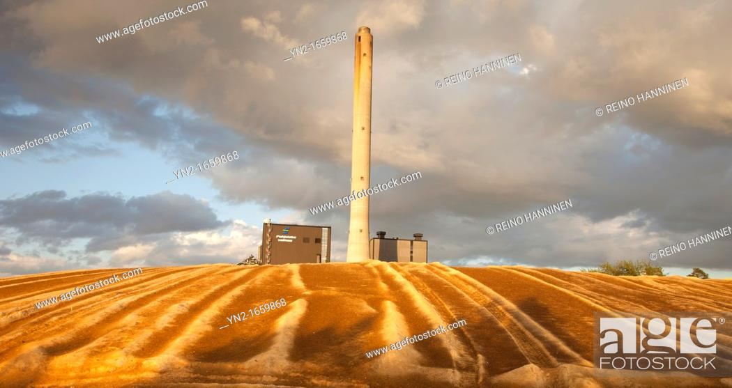 Stock Photo: Peat burning district heating/power plant producing electricity and heating water  Uses peat, sawdust and wood chips as primary fuel  Location Oulu Finland.