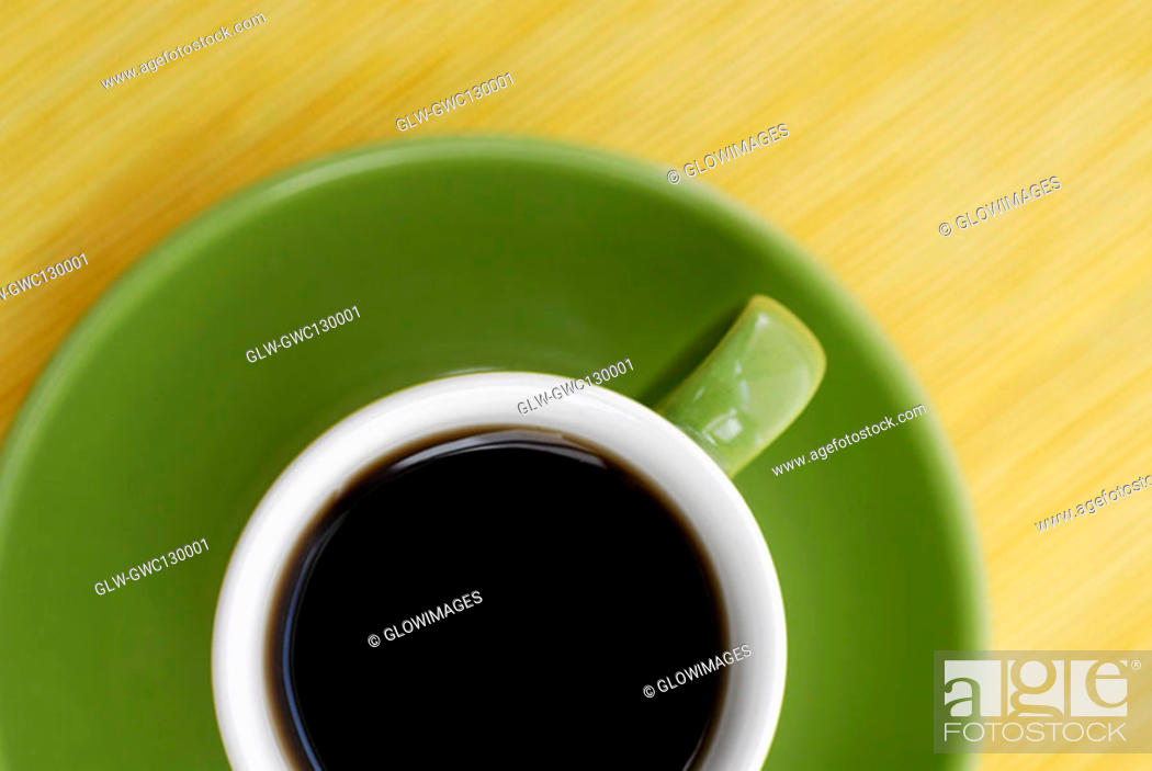 Stock Photo: High angle view of a cup of black tea on a saucer.