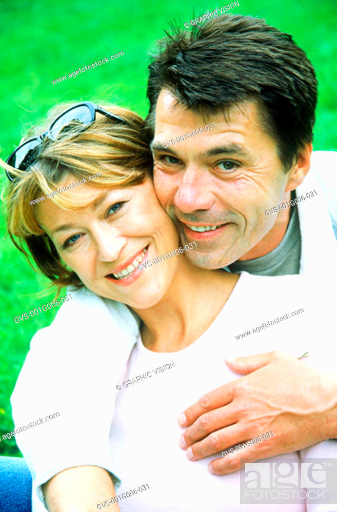 Stock Photo: Portrait of mature couple hugging.