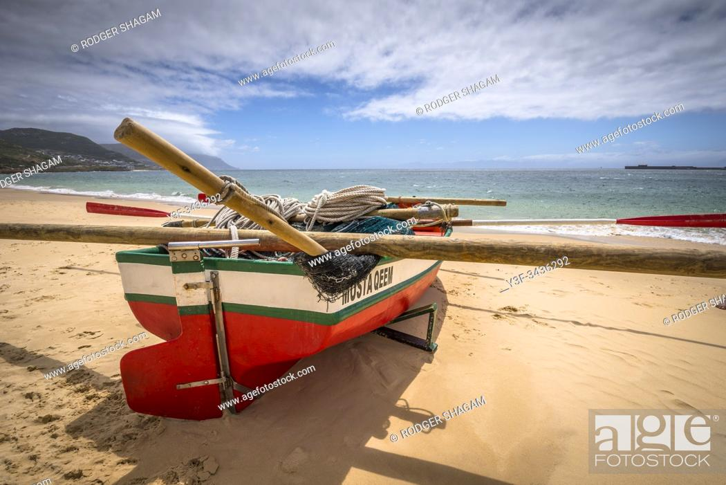 Stock Photo: Trek fishing boat ready to put to sea to drop it's net. There is a lookout on the mountain behind the beach who watches for the shoal to arrive.