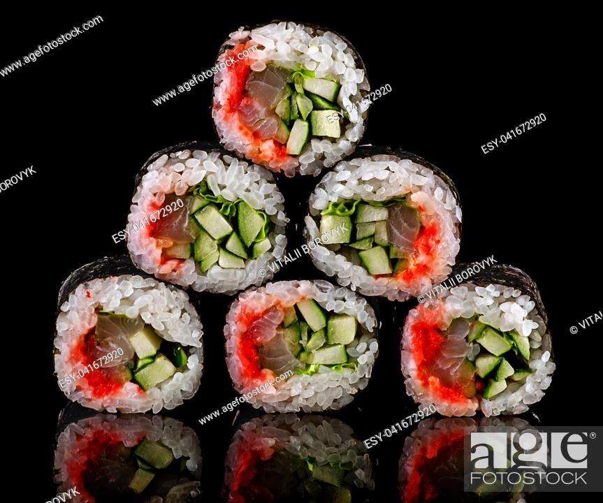 Stock Photo: Pyramid of rolls spicy lollo-ross on a black background with reflection.