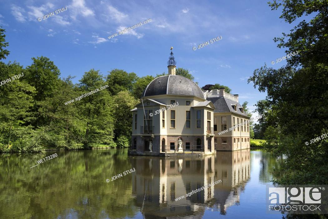 Stock Photo: Manor house Trompenburg reflecting in its pond is an important estate near the Dutch village 's-Graveland.