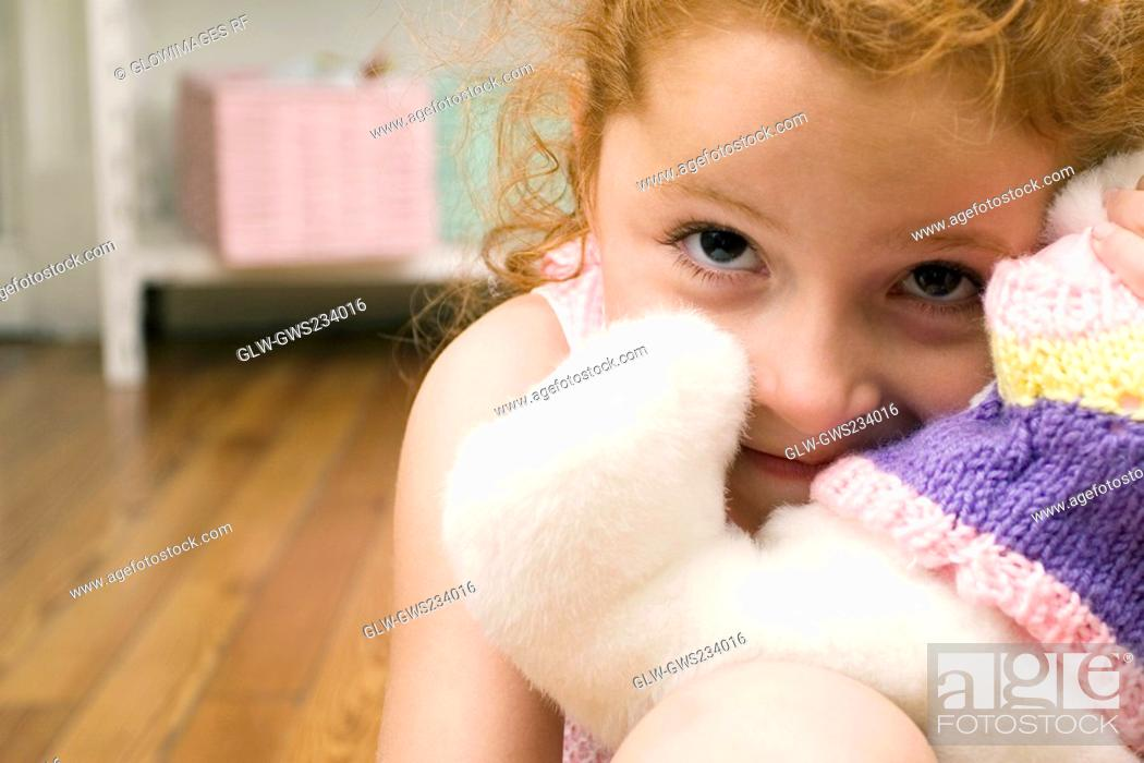 Stock Photo: Portrait of a girl with a toy.