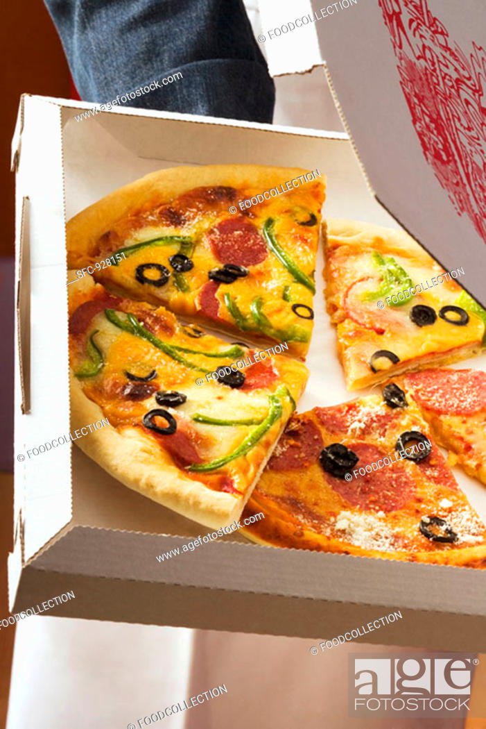 Stock Photo: Pieces of different pizzas in pizza box.
