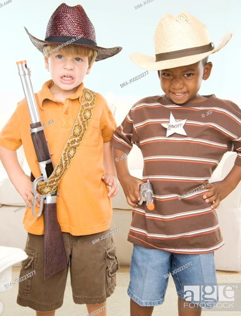 Stock Photo: Two young boys dressed as cowboys.