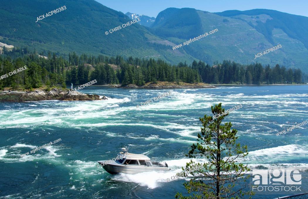 Stock Photo: Experienced boater braves Skookumchuck Narrows, ebb tide Sechelt Inlet, Sunshine Coast, British Columbia, Canada.