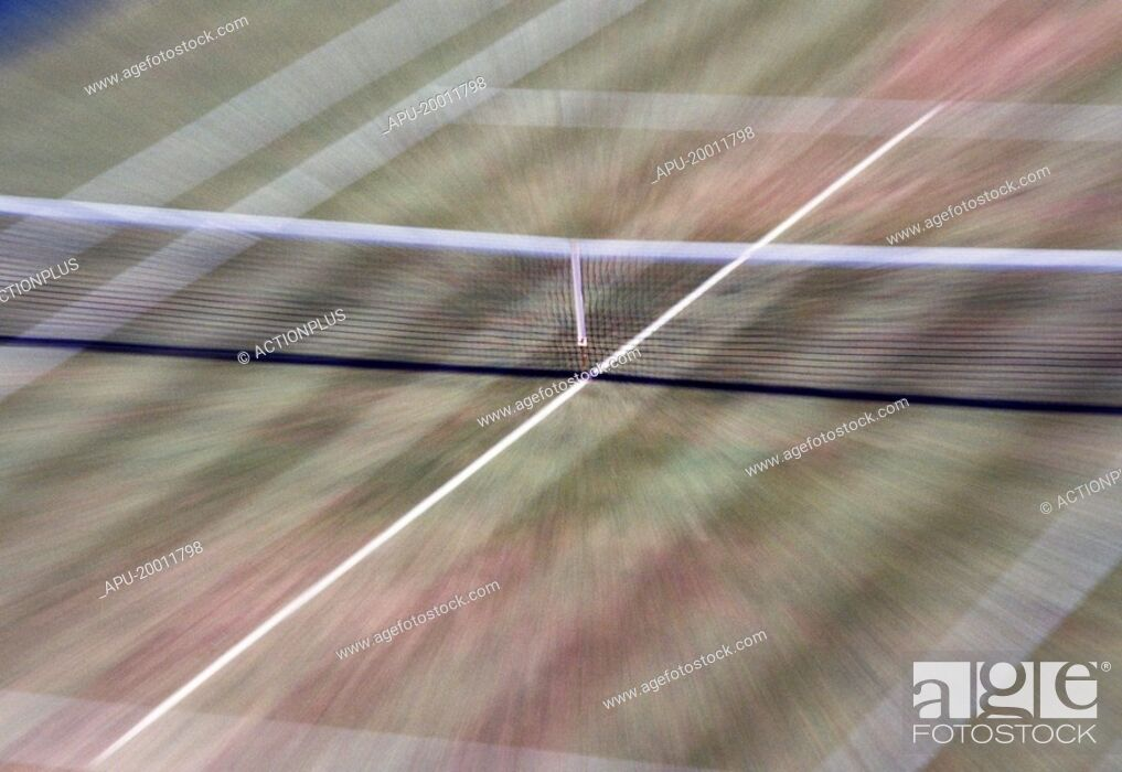Stock Photo: Blurred view of grass tennis court and net.