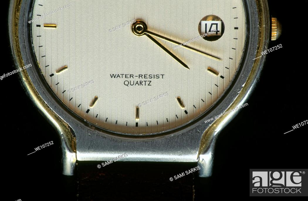Stock Photo: Face of a wristwatch telling the time.