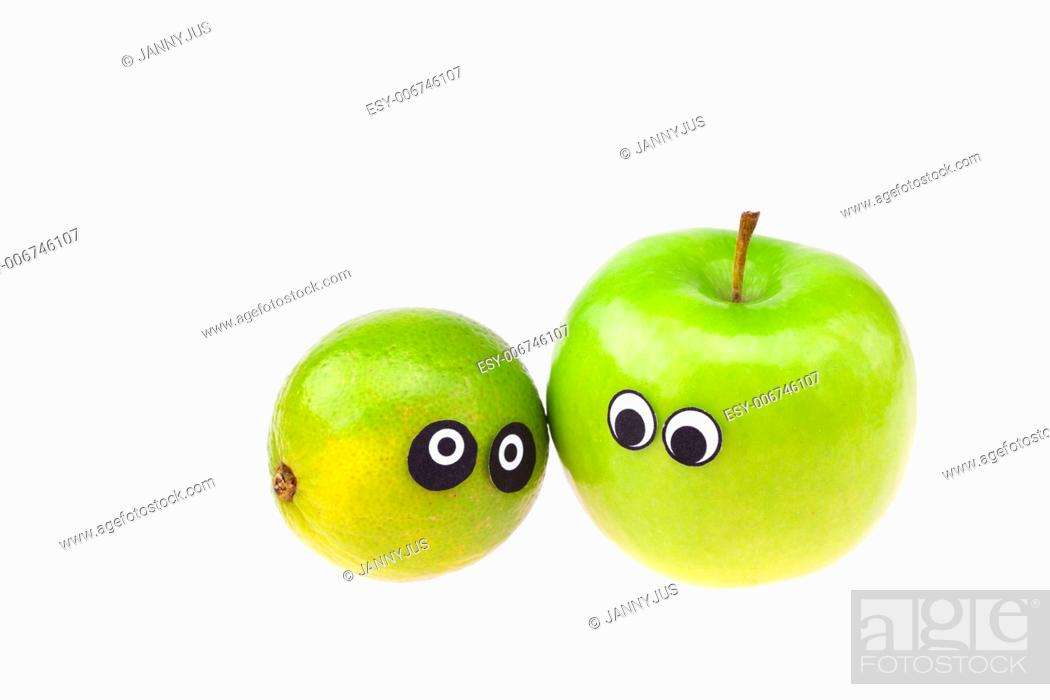 Imagen: lime and apple with eyes and faces isolated on white.
