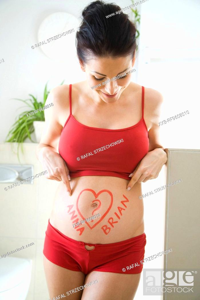 Stock Photo: Pregnant woman waiting for her baby to come.