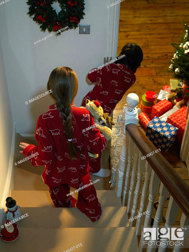 Stock Photo: Children walking downstairs on christmas eve.