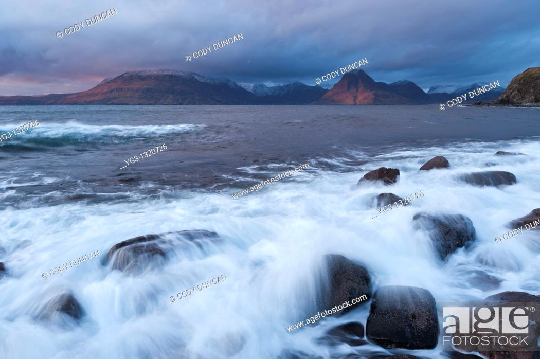 Stock Photo: Waves crash over rocky shore at Elgol, Isle of Skye, Scotland.