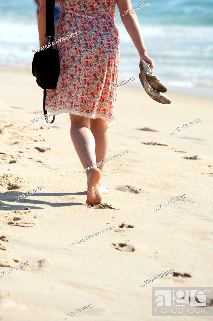 Stock Photo: Atlantic Ocean beach, Atlantic Ocean coast, woman walking barefoot on the beach, Portugal.