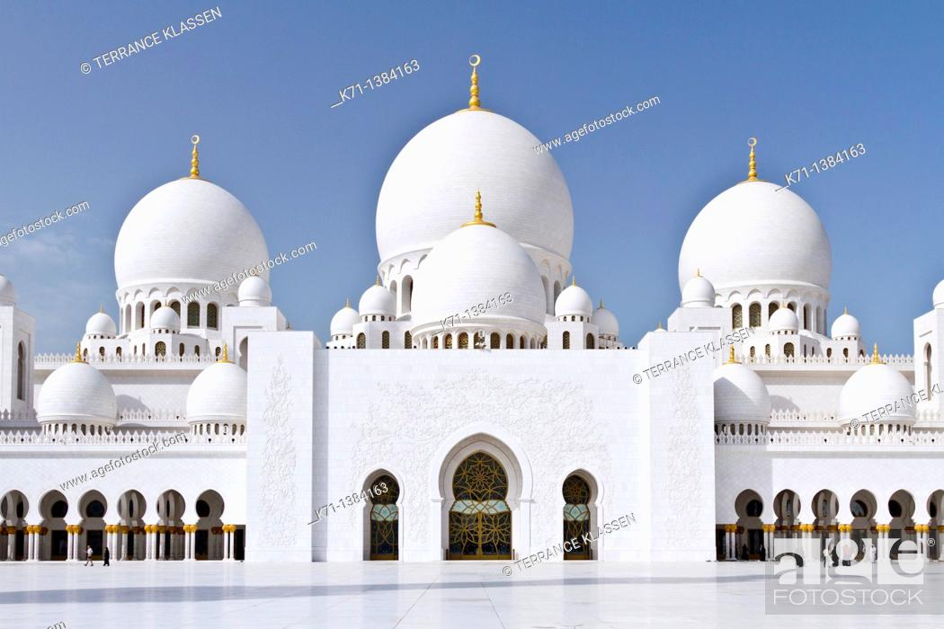 Stock Photo: Exterior domes, arches and minarets of the the Sheikh Zayed Grand Mosque in Abu Dhabi, UAE.