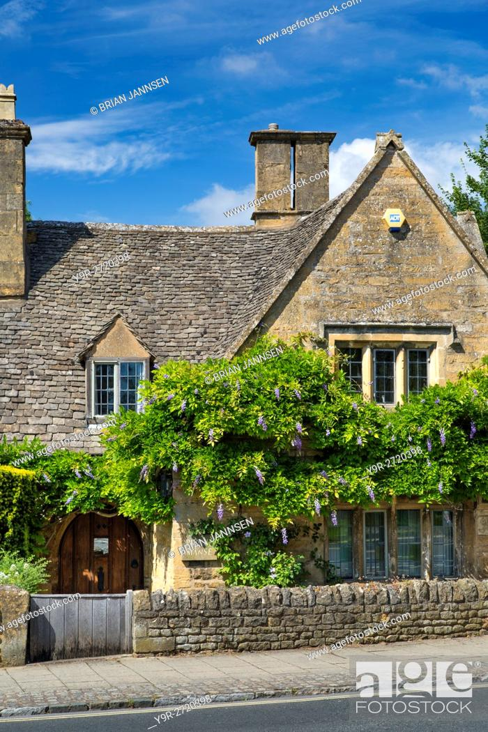 Stock Photo: Wysteria covered home in Broadway, the Cotswolds, England.