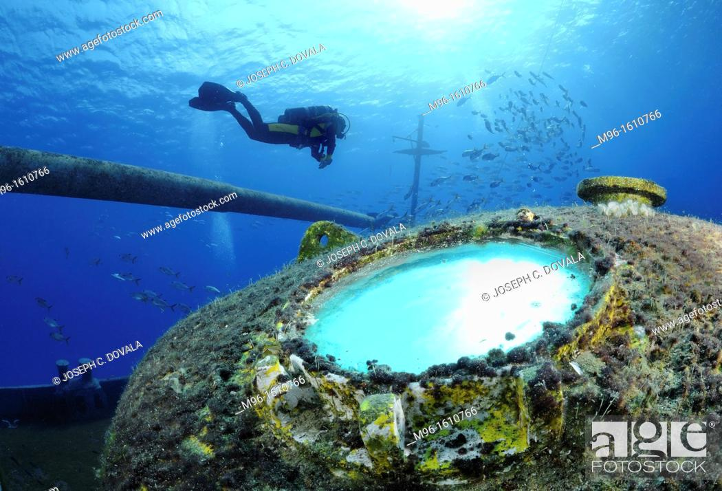 Stock Photo: Scuba diver explores ship wreck, Grand Cayman Island, Cayman Islands, Caribbean.