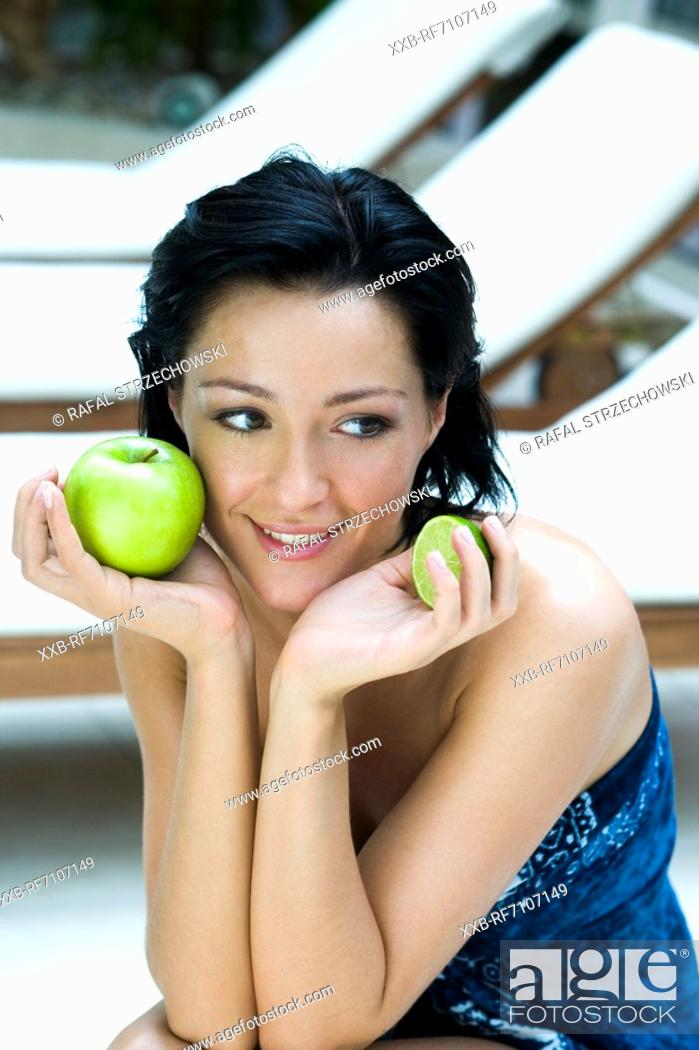 Stock Photo: Woman with fruits.