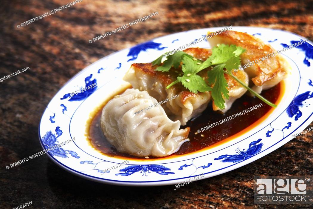 Stock Photo: Beef dumplings with sesame seeds and coriander leaves.