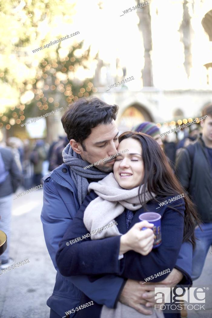 Stock Photo: romantic couple at christmas market in Munich, Germany.