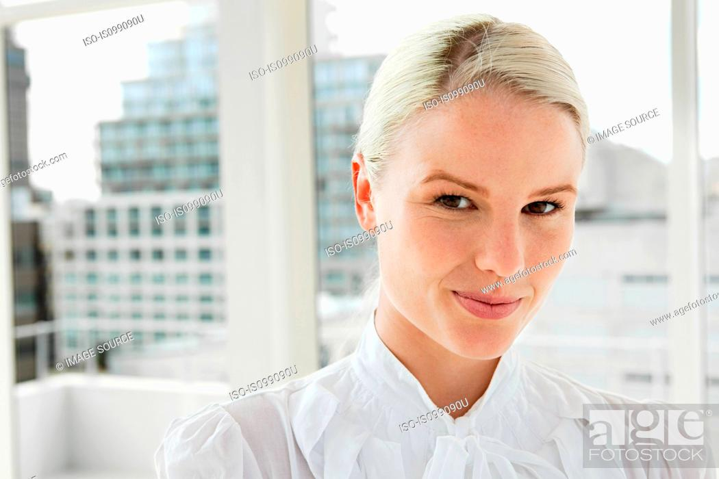 Stock Photo: Businesswoman wearing white blouse, portrait.
