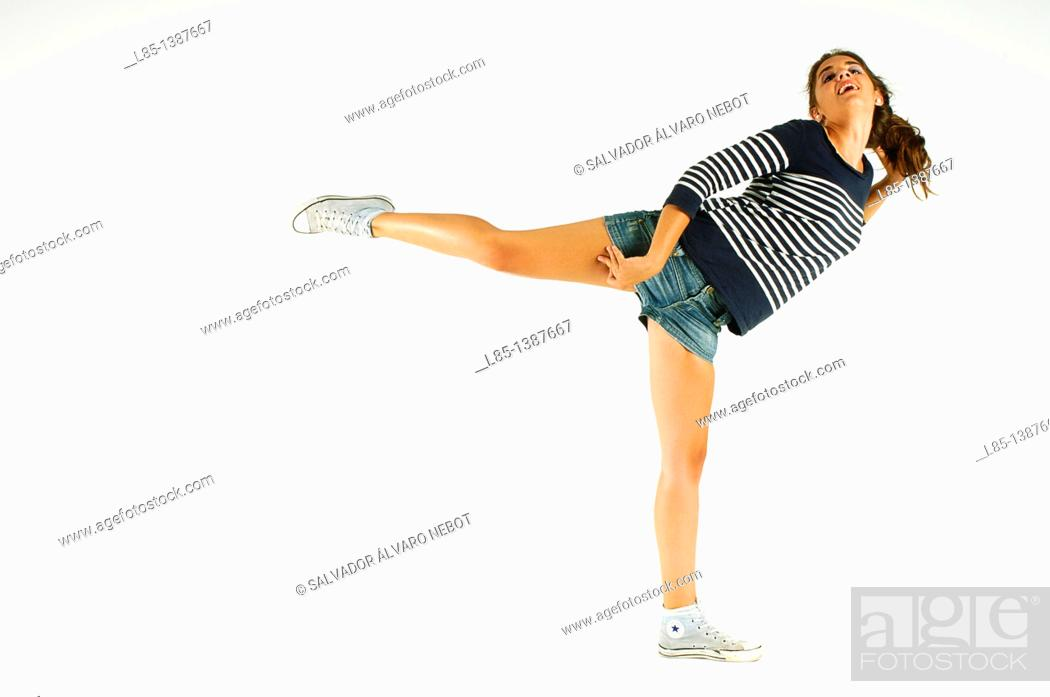 Stock Photo: Young girl dancing on a white background.