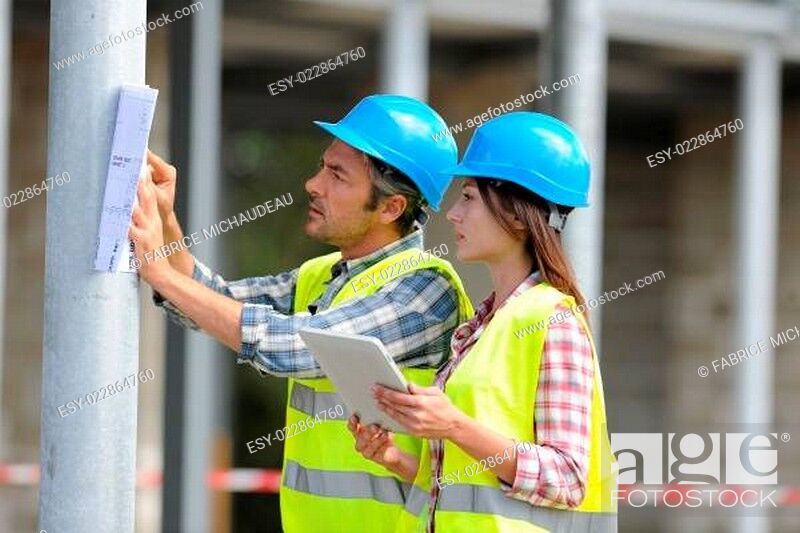 Stock Photo: Construction people using electronic tablet on site.