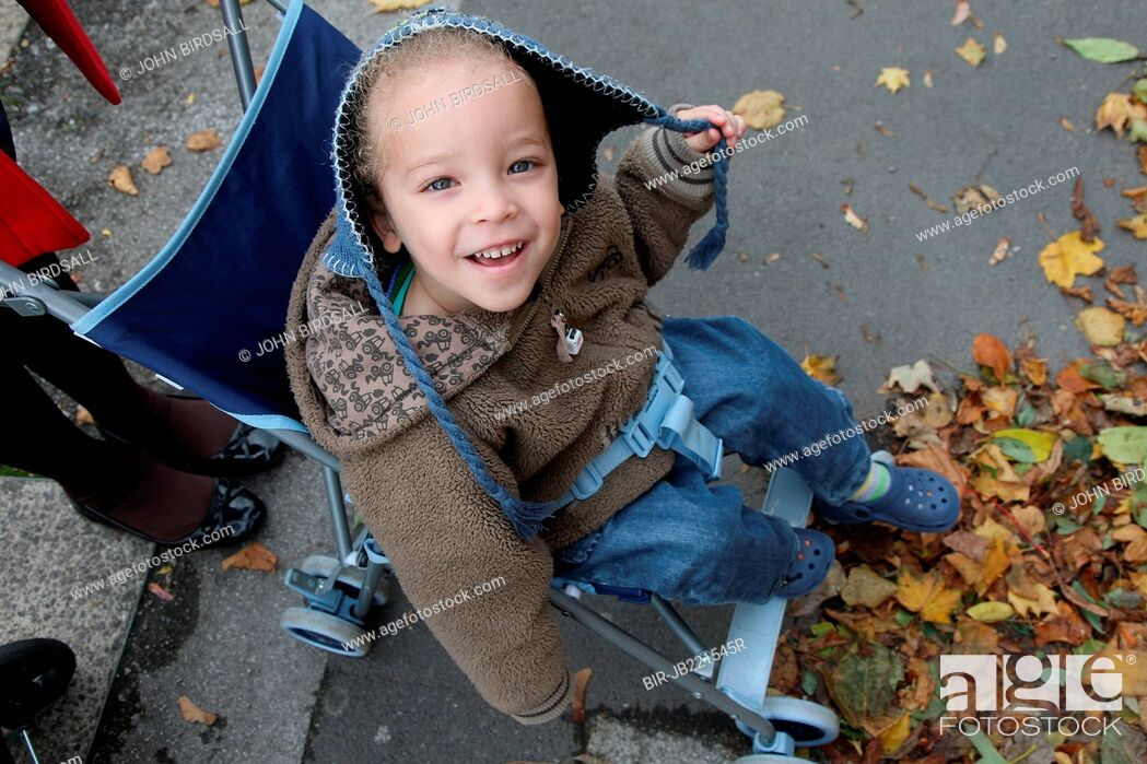 Stock Photo: Toddler in coat smiling, dual heritage, boy.