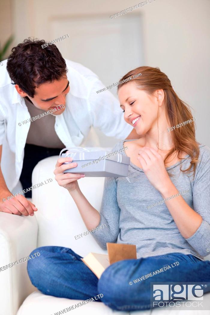 Stock Photo: Young woman happy about the gift she just got from her boyfriend.
