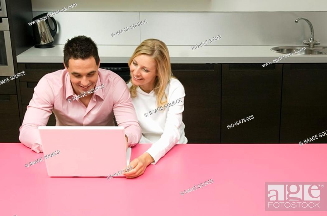 Stock Photo: Couple using internet.