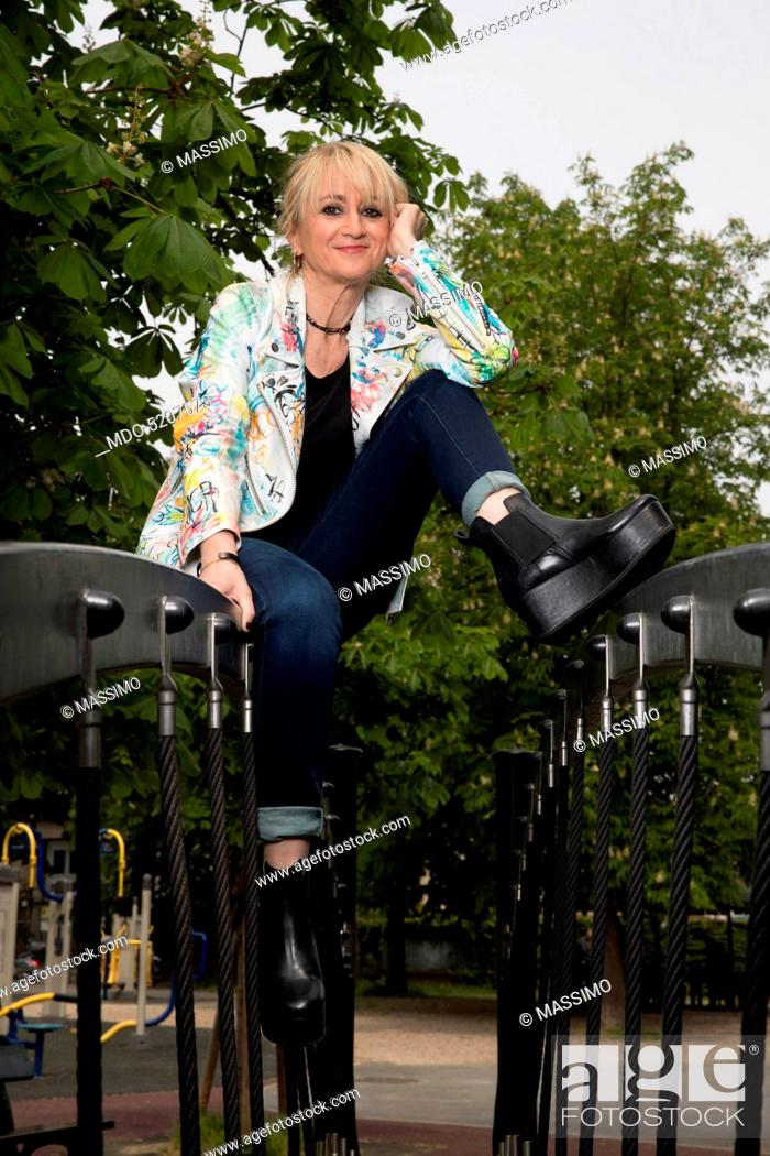 Imagen: Actress and comedian Luciana Littizzetto sitting in a playground inside the public park Parco del Valentino. Turin, Italy. 21st April 2016.