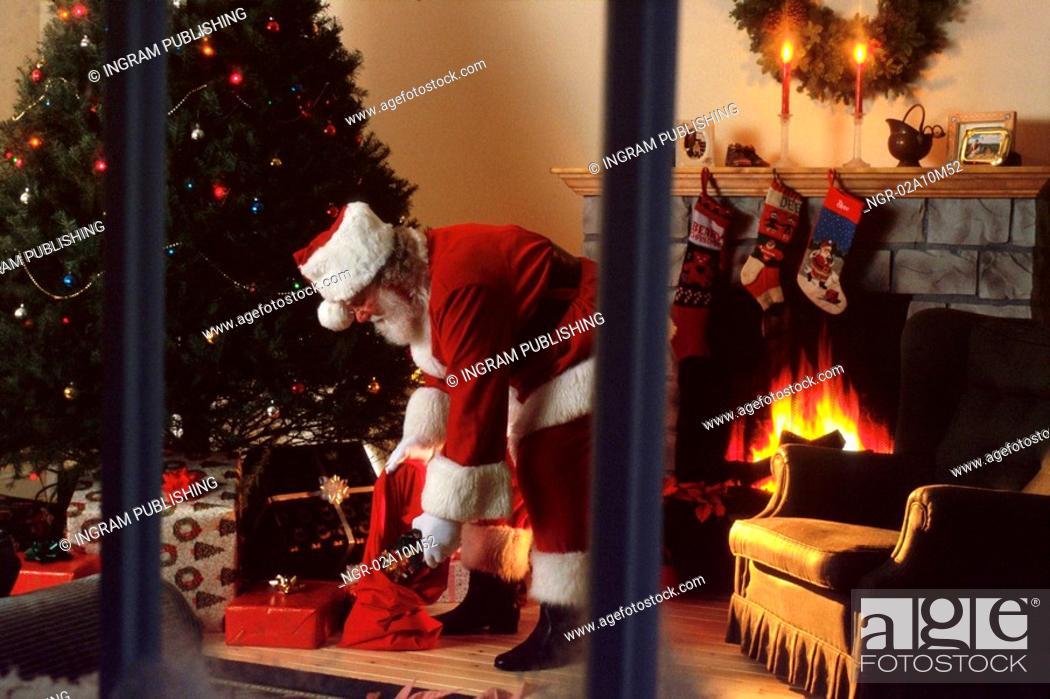 Stock Photo: Santa Leaving Presents.