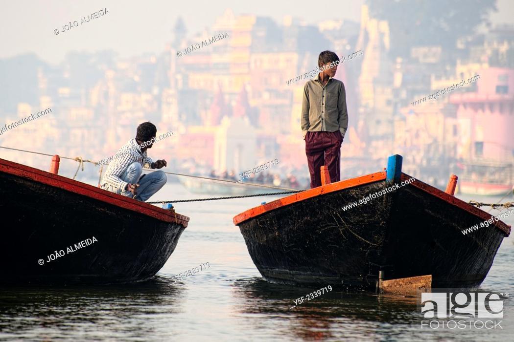Stock Photo: The boatmen that row the boats along the ghats of Varanasi.