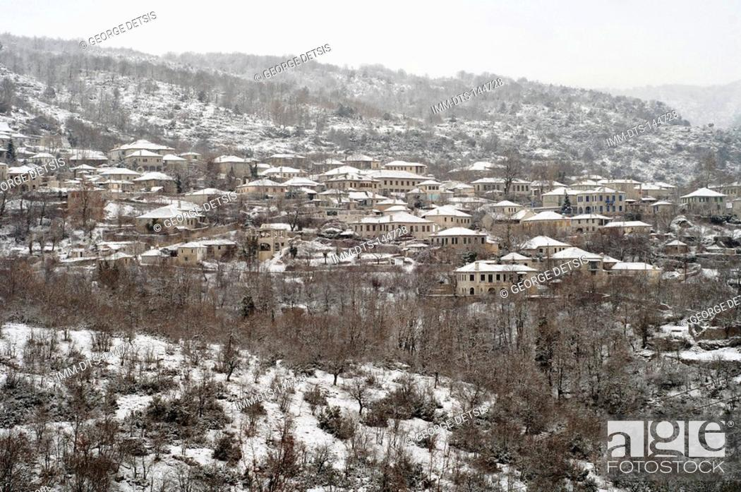 Stock Photo: View of Monodendri village covered in snow. Monodendri, Zagorohoria, Ioannina, Greece, Europe.