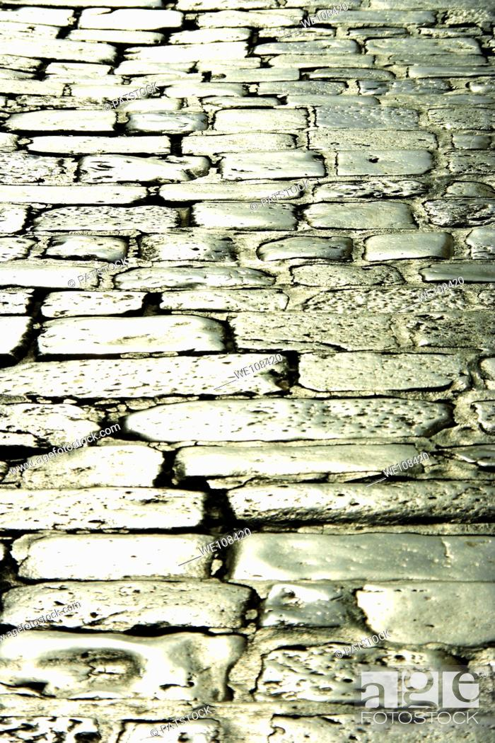 Stock Photo: Sun reflexing in the stone pavement in Hvar town, Croatia.