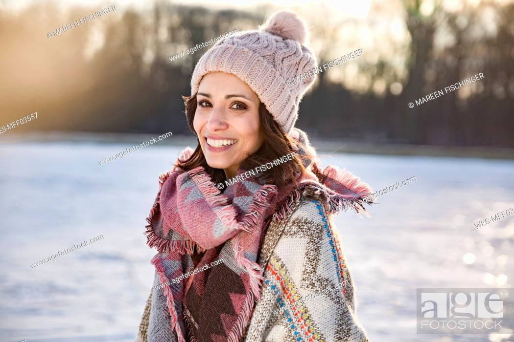 Stock Photo: Portrait of happy woman outdoors in winter.