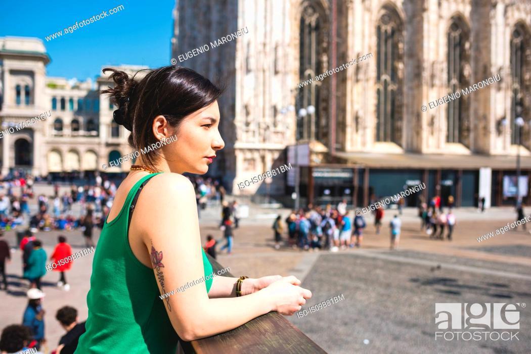 Stock Photo: Woman outside Il Duomo, Milan, Italy.