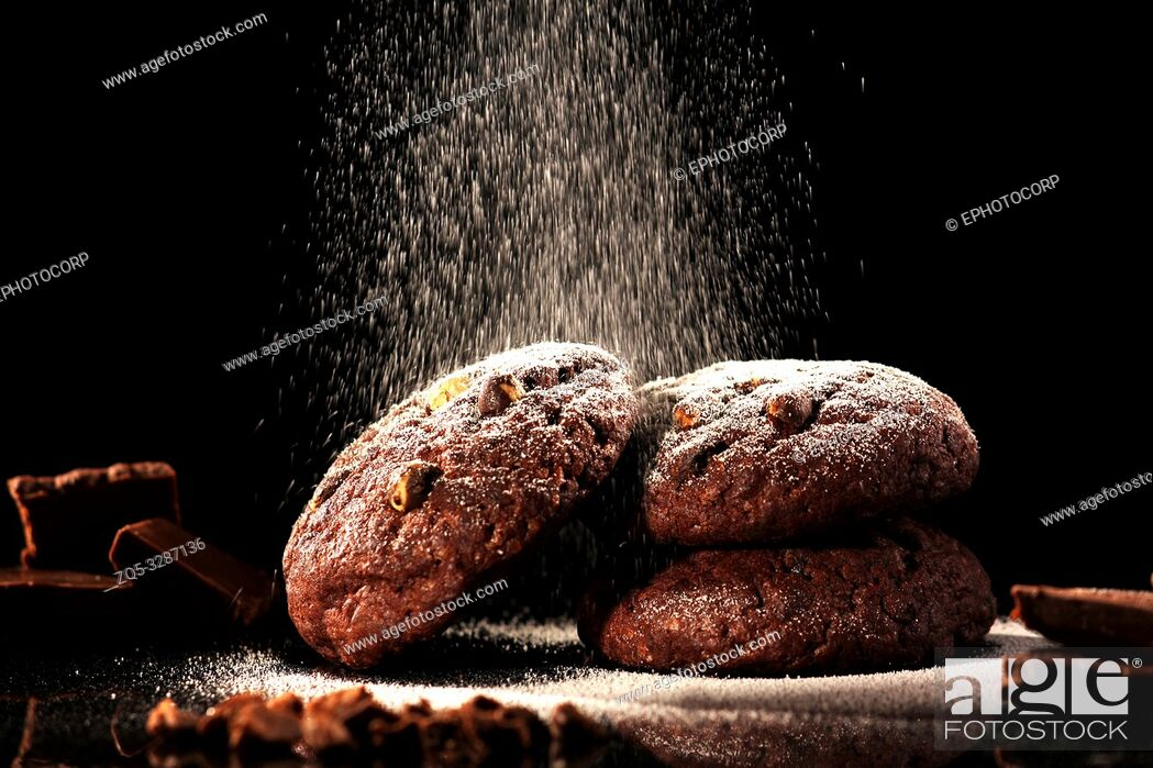 Stock Photo: Chocolate chip cookies against a black background.
