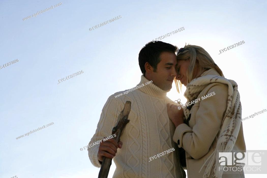 Stock Photo: Young affectionate couple outdoors.