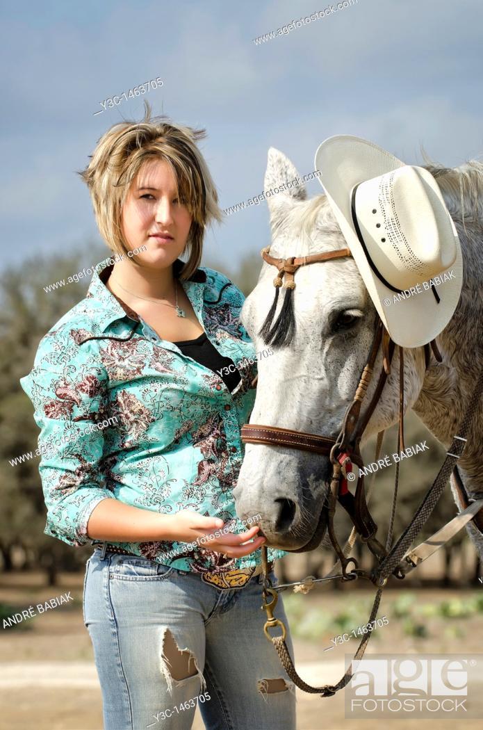 Stock Photo: Horseback riding cowgirl.