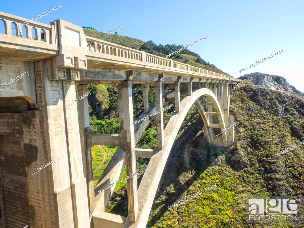 Stock Photo: Rocky Creek Bridge is a reinforced concrete open-spandrel arch bridge in California, built in 1932. It is located in Monterey County a few miles south of.